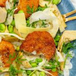 Crab Cakes with fennel, artichoke and broad bean salad