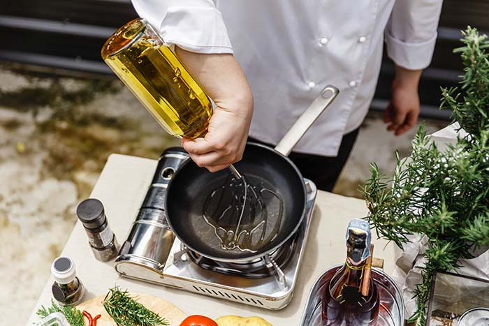 Chef using cooking oil