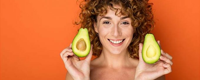 Woman holding avocados
